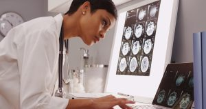 Black woman examining MRI images
