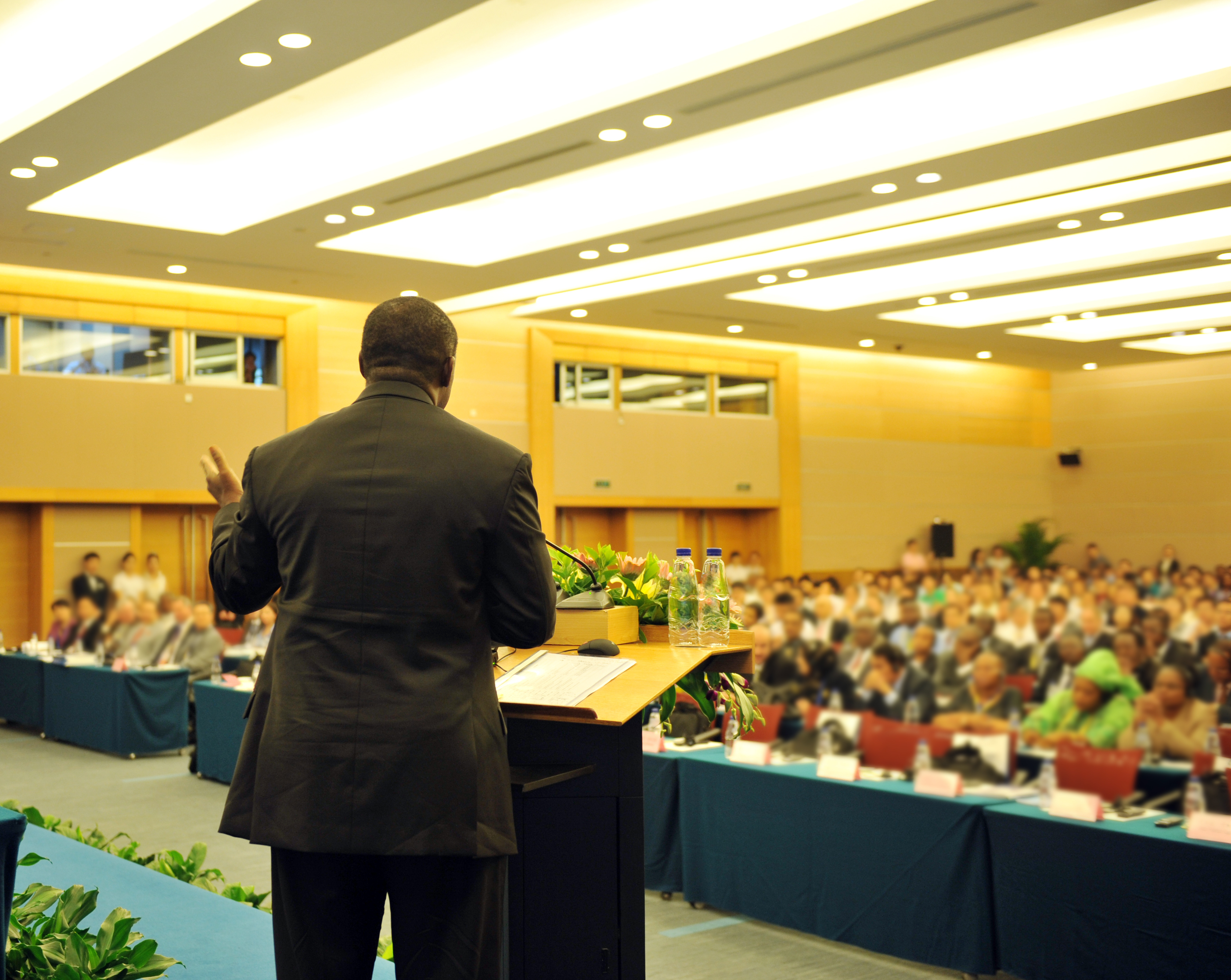 Black man giving a speech at a conference